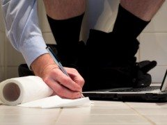 27% of Britons regularly 'hide' in the toilets at work to pass time