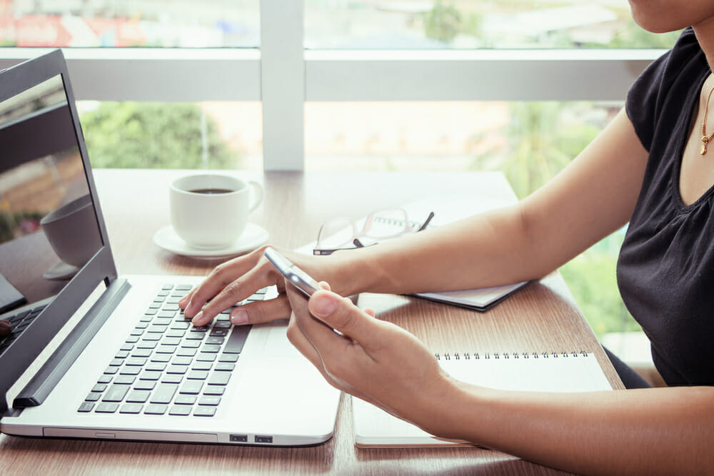 Close up of young woman home office technology