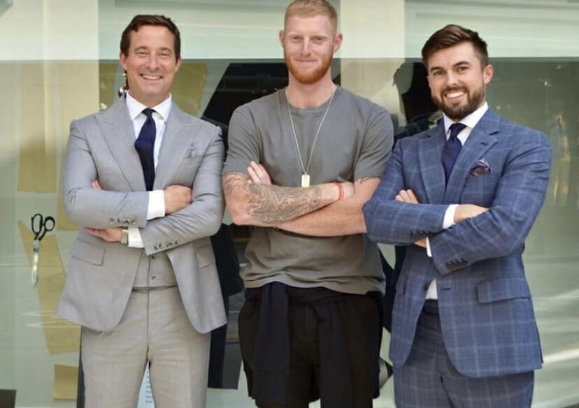 Ben Stokes with Neil McCann and tailor, Jack, pose outside McCann Bespoke